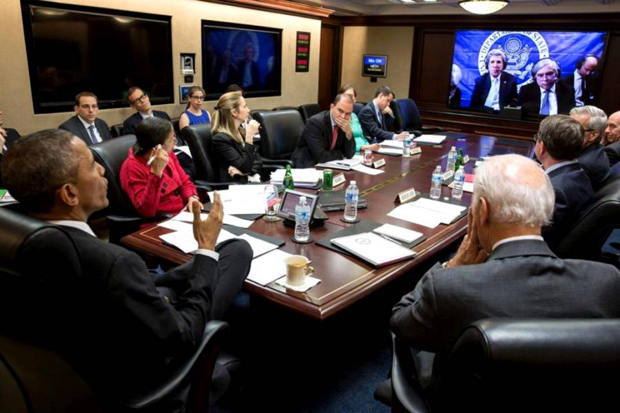 U.S. President Barack Obama receives an update in the Situation Room at the White House in Washington from Secretary of State John Kerry during the Iran nuclear talks in this White House handout photo