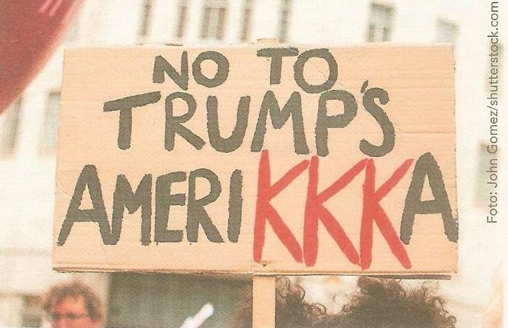 Пплакат-протест против расистской политики Трампа с проекцией на Ку-Клукс-Клан (ККК)