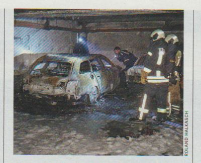 Сгоревшая машина преступников в подземном гараже